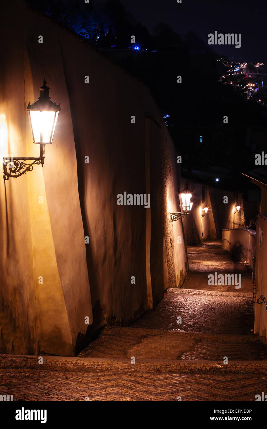 staircase alley with lanterns in Prague at night Stock Photo