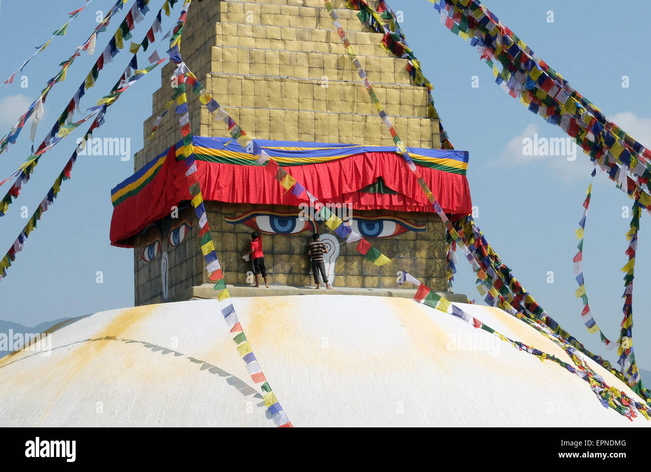 Men painting the eyes of the Stupa at Boudhanath, Kathmandu. - Stock Image