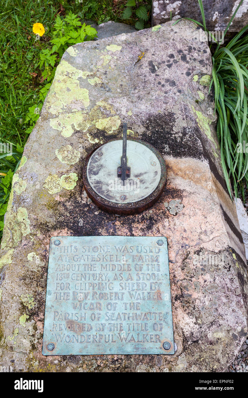 Revd Walker's 'Clipping Stone' now used as a sundial at Holy Trinity Church, Seathwaite, Dunnerdale, - Stock Image