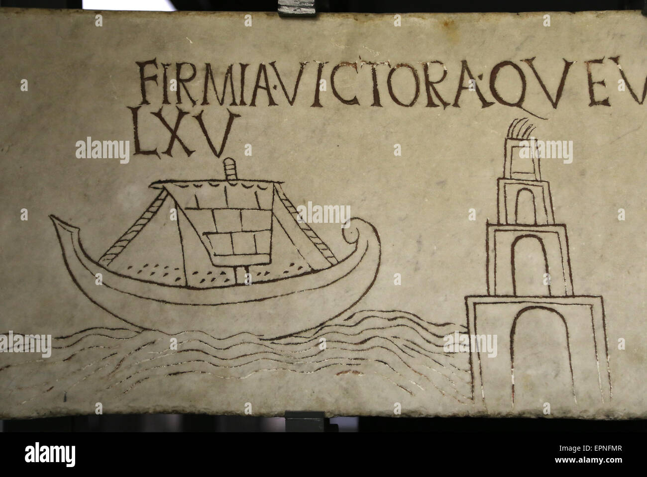 Slab with decoration. Inscription of Firmia Victoria with ship and lighthouse. Vatican Museum. Early Christians. - Stock Image