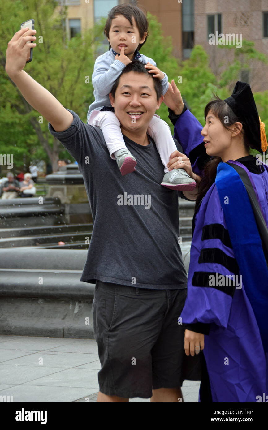 An Asian family taking a selfie after the mother's graduation from NYU. In Washington Square Park in New York - Stock Image