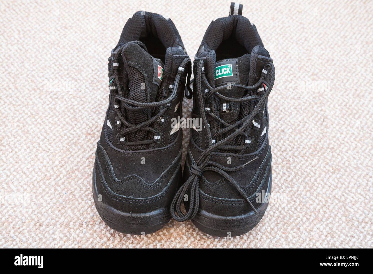 Pair new Click womens' black work safety trainers - Stock Image