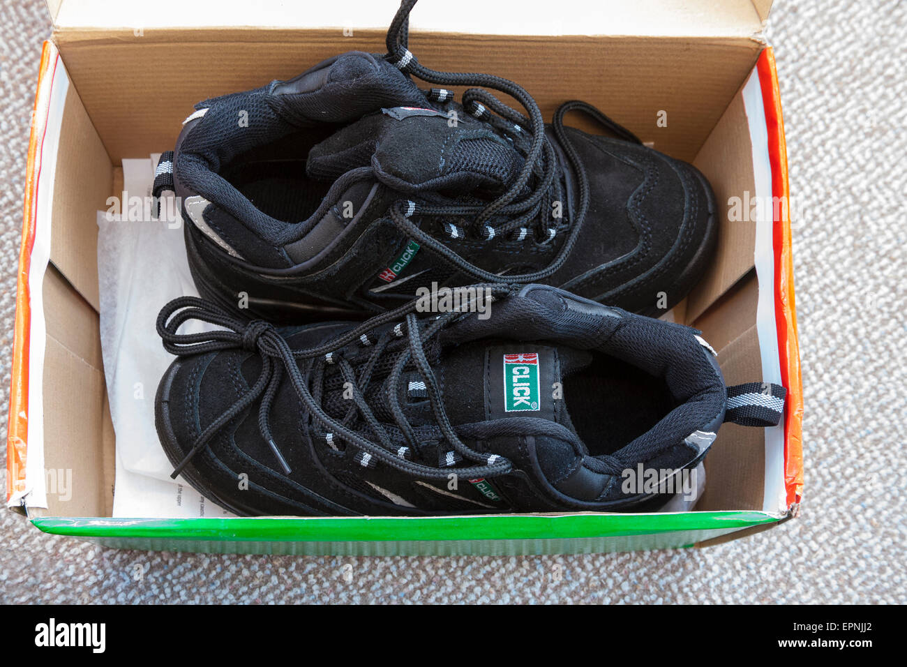 Pair new Click womens' black work safety trainers in box - Stock Image