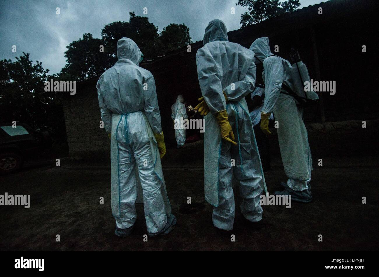 Ebola burial team working at night. Pendembu, Sierra Leone. - Stock Image