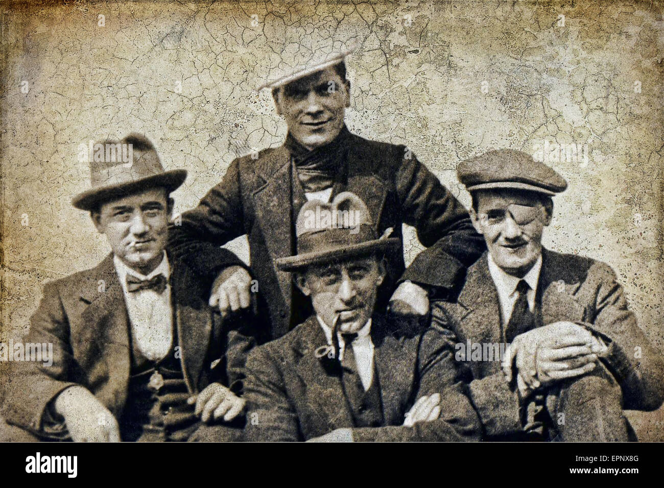 A black and white photograph of a gang of men in the 1920s that was bought back to life using sepia tones and textures. - Stock Image