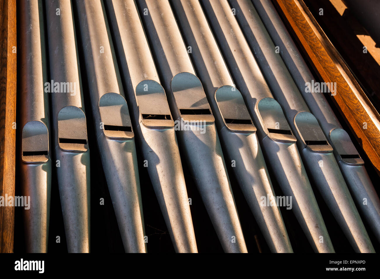The organ pipes inside Matterdale Church, near Dockray, Lake District, Cumbria - Stock Image