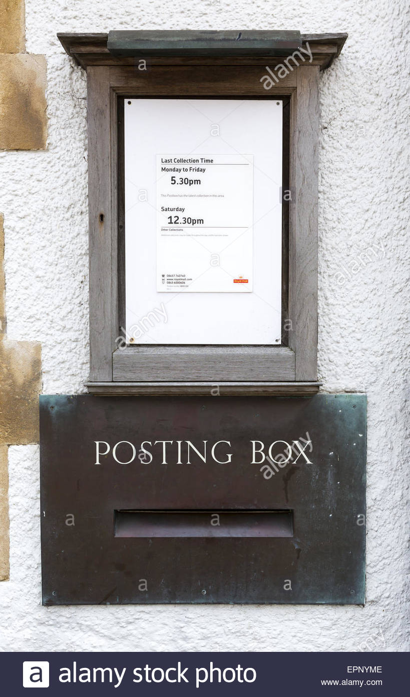 Brass Post Office posting box plate with wooden framed collection times notice - Stock Image