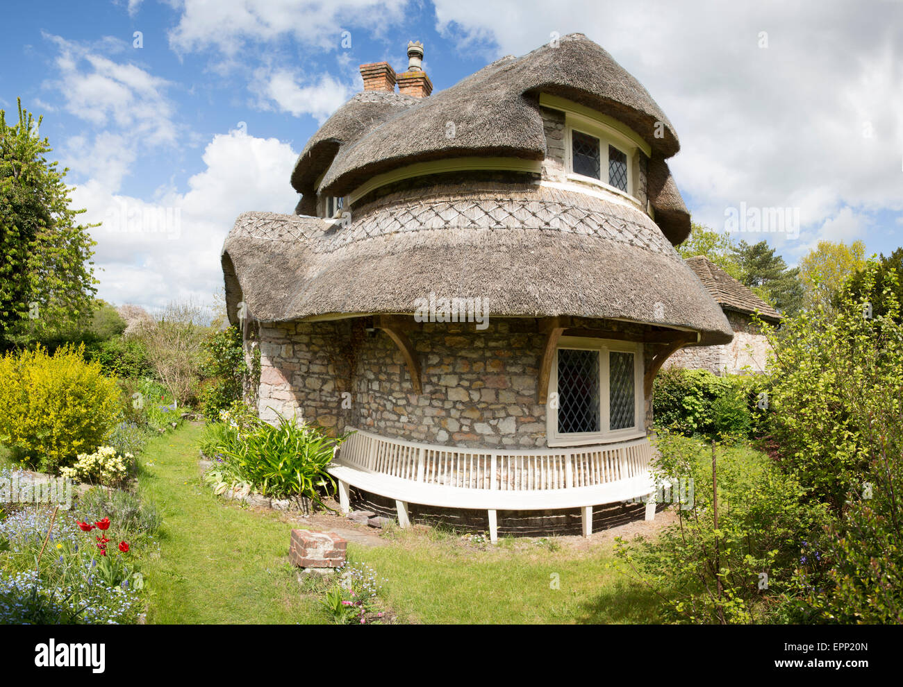 Circular Cottage Blaise Hamlet - a collection of pretty cottages in the vernacular style on the Blaise estate in - Stock Image