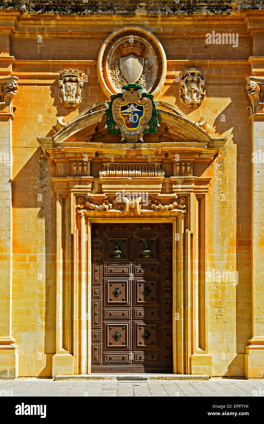 Coat of Arms of the archbishop above the portal to the St. Paul's Cathedral, Mdina, also Città Vecchia - Stock Image