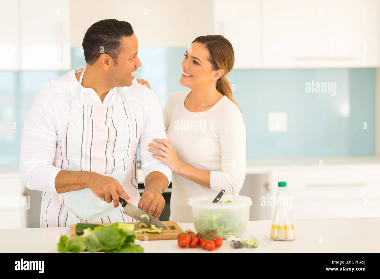 romantic middle aged couple in kitchen cooking food Stock Photo ...