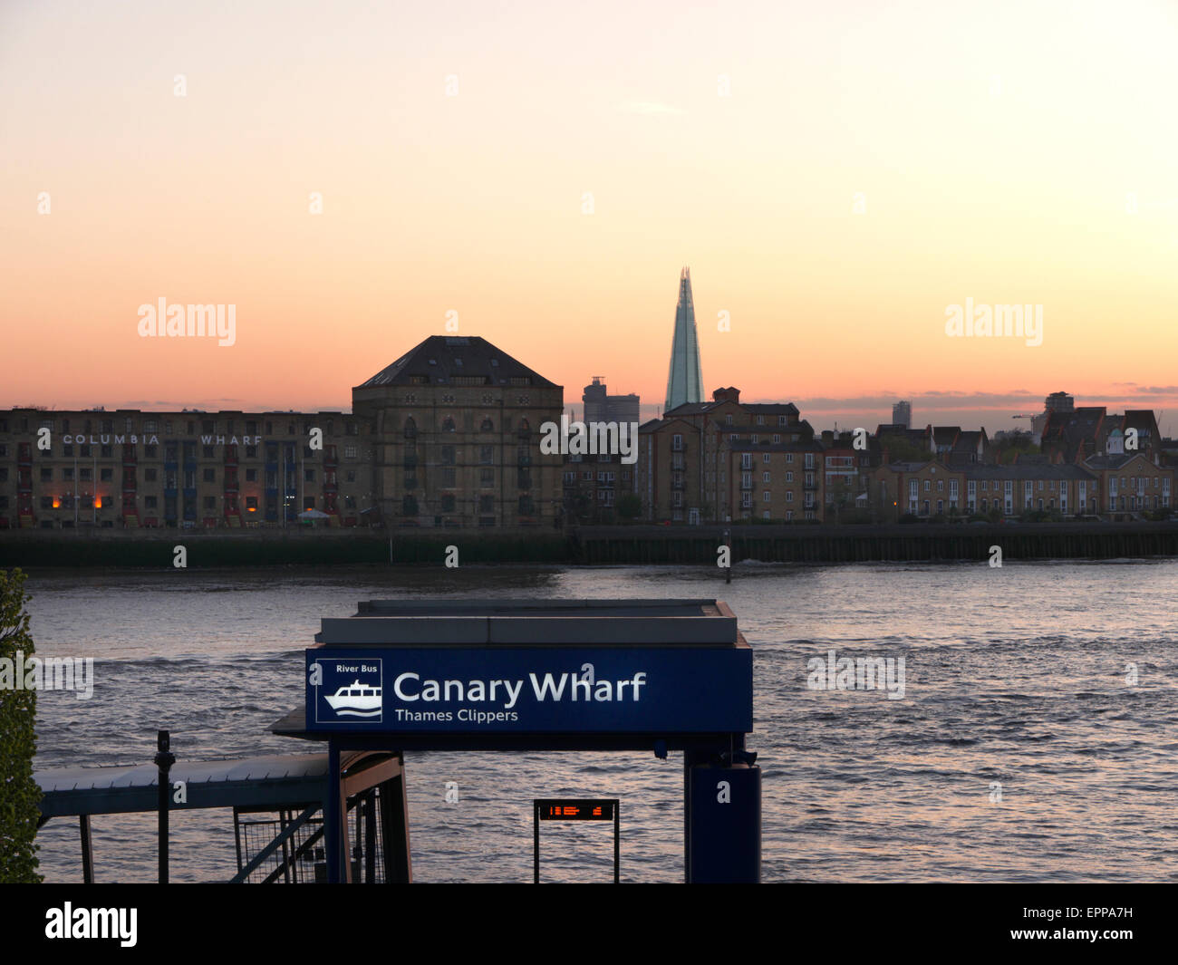 Pier embarkation point for Thames Clipper River boats, Columbia Wharf and Shard buildings behind, Canary Wharf London - Stock Image