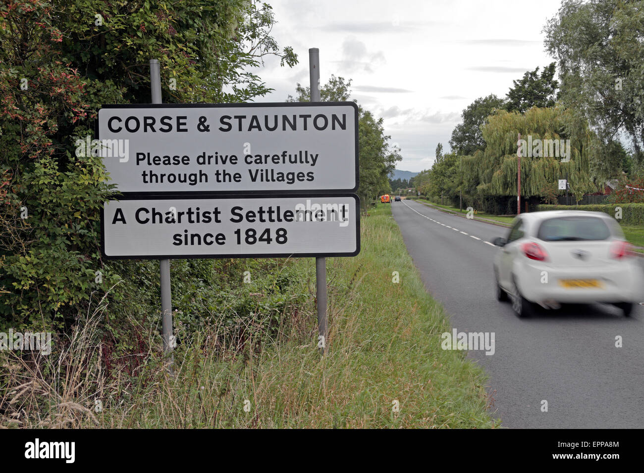 Road sign at the entrance to the villages of Corse & Staunton, Chartist settlements since 1848, Gloucestershire, - Stock Image