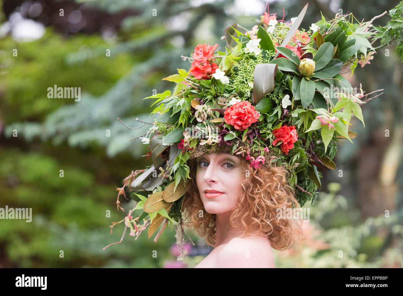 RHS Chelsea Flower Show, portrait of a model with a large floral headdress at the Hillier Nurseries tradestand Stock Photo