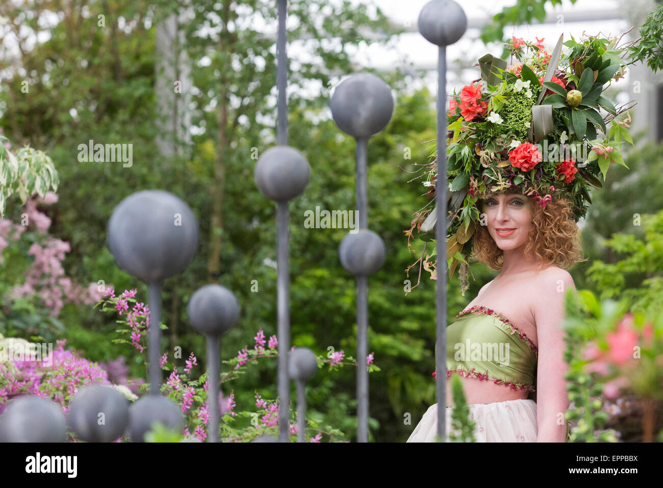 RHS Chelsea Flower Show, model with a large floral headdress at the Hillier Nurseries tradestand Stock Photo