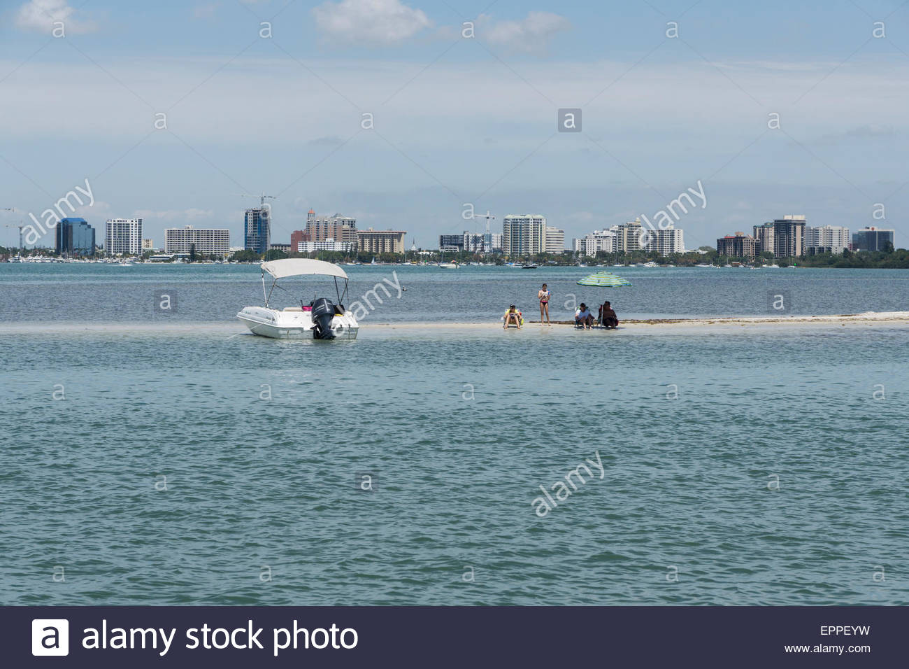 Boaters relax on a sand bar in Sarasota Bay at Sarasota, Florida - Stock Image