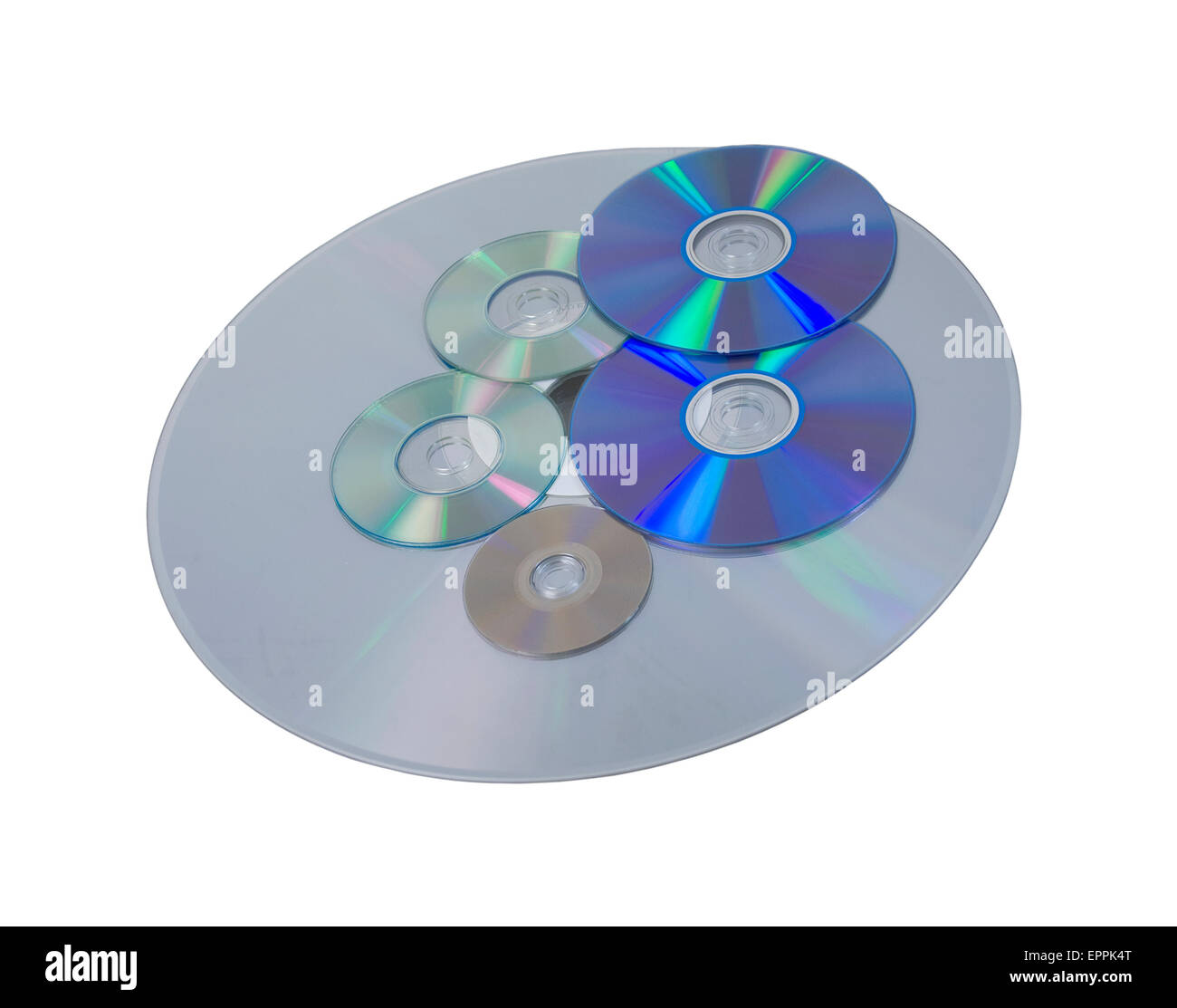 Several disks of various sizes and different formats for storing and retrieving data - path included - Stock Image