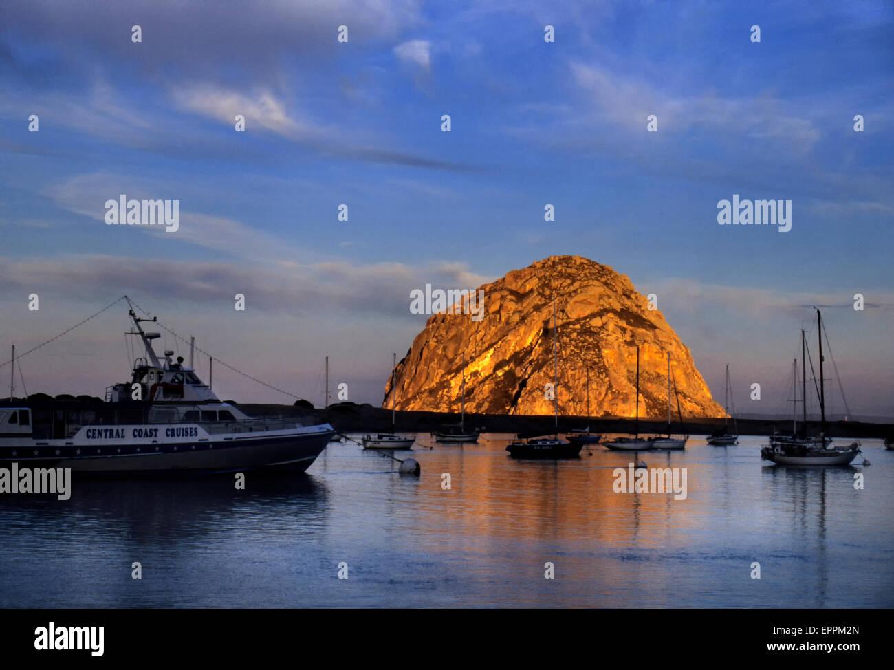 Morro Rock and bay at sunrise, central California - Stock Image
