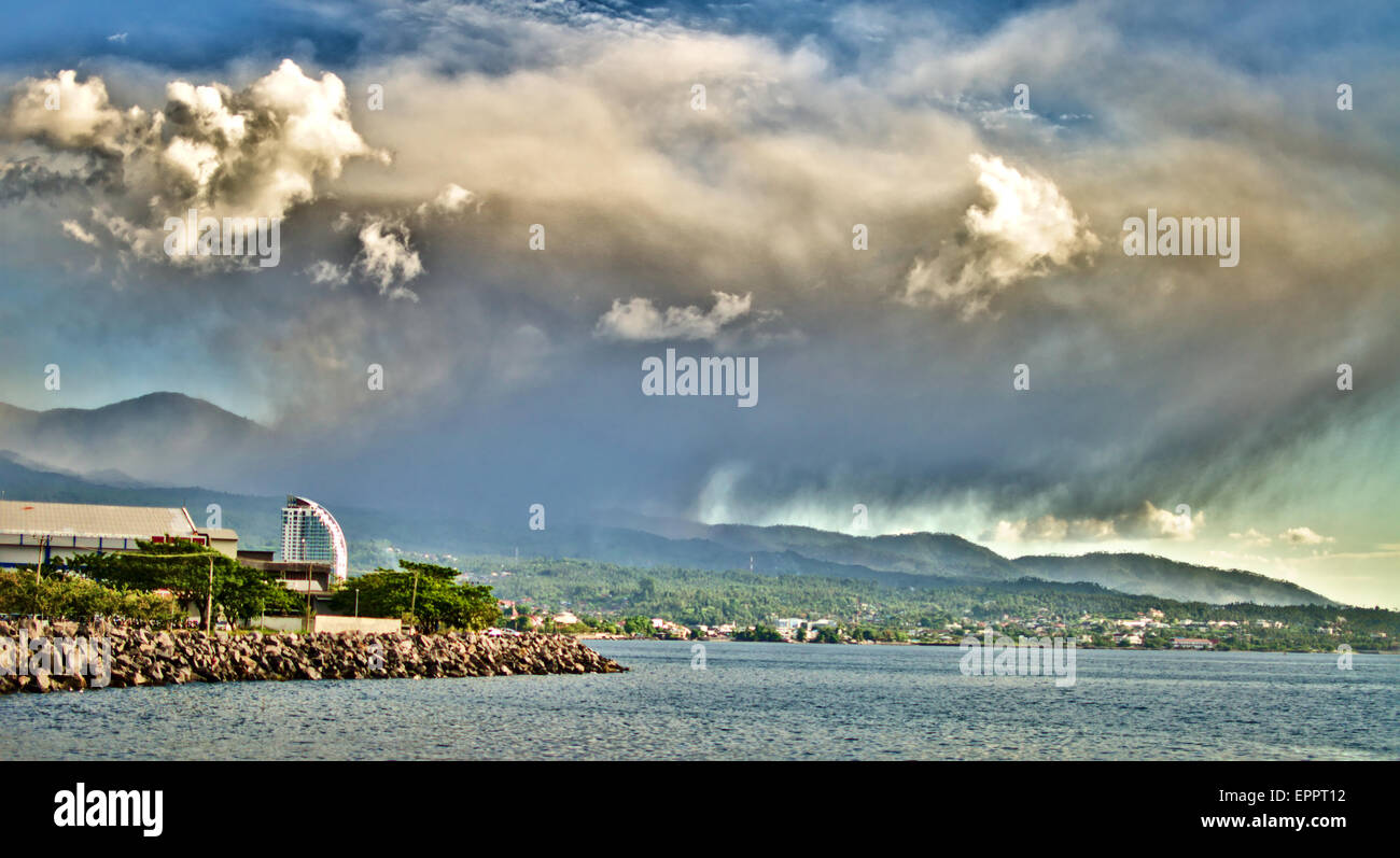 A large cloud of ash spews out of Lokon volcano in North Sulawesi, Indonesia near the city of Tomohon on Wednesday - Stock Image