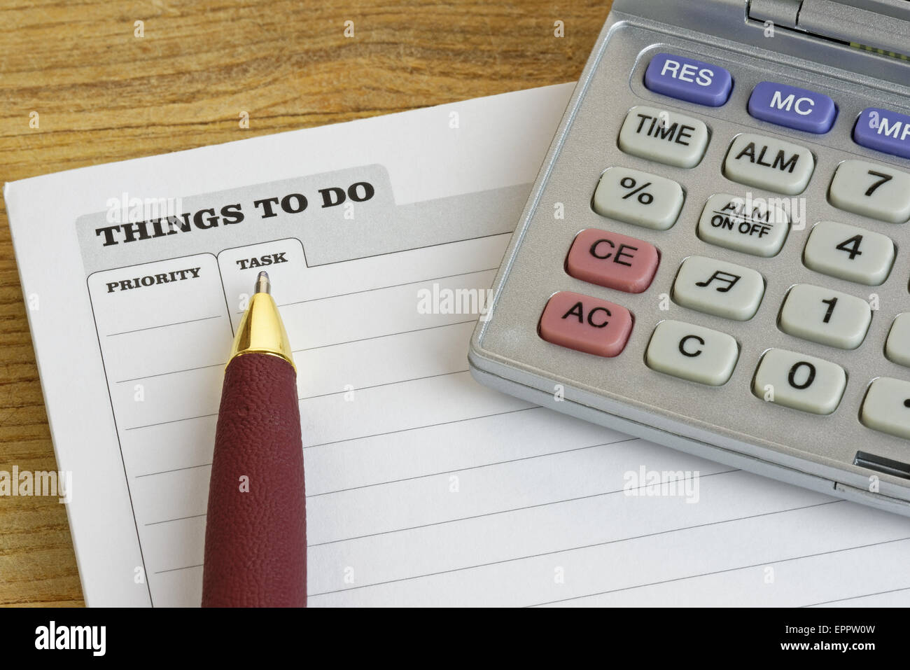 Pen and calculator on a 'Things To Do' pad - Stock Image