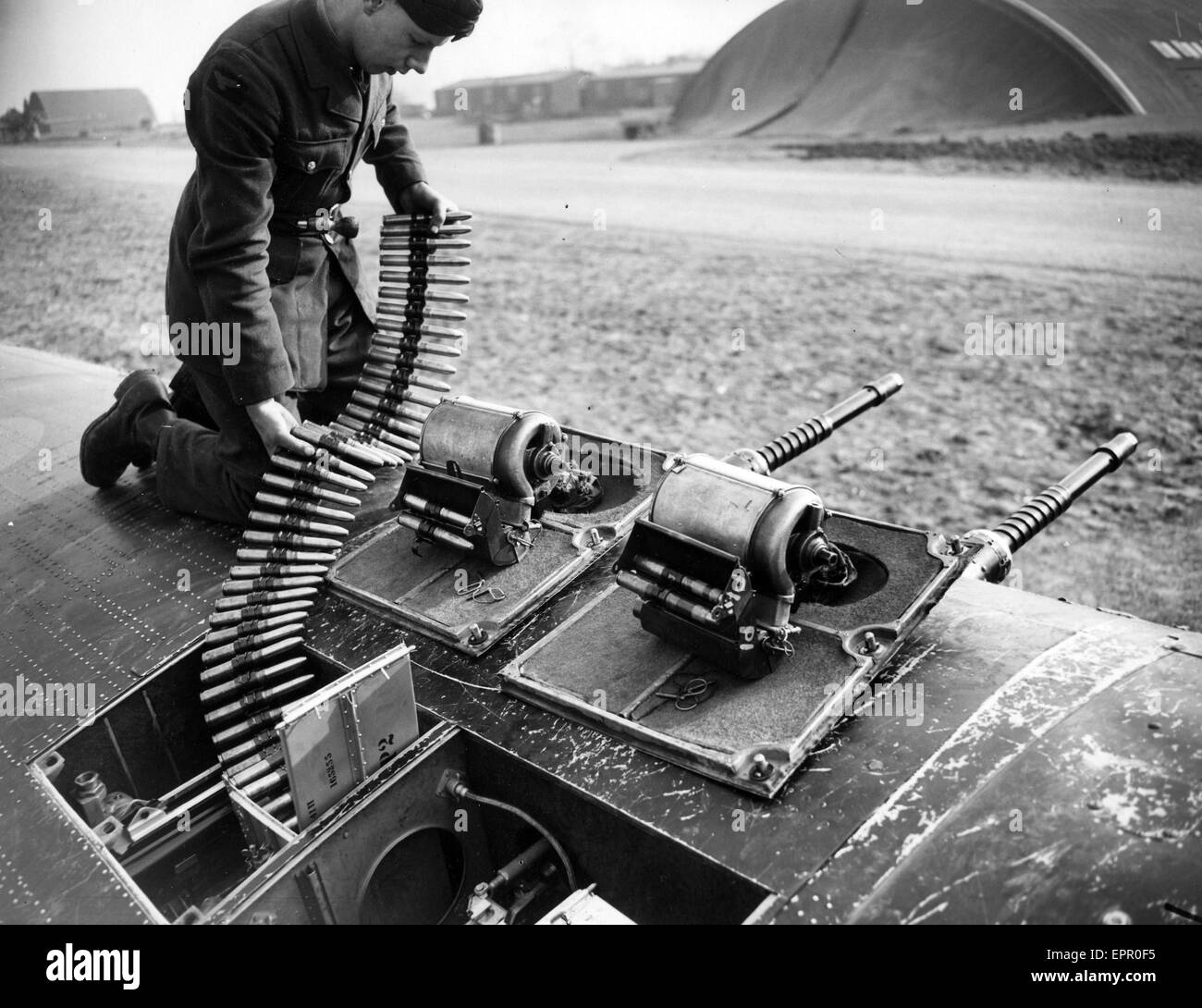 HURRICANE CANNONS. Loading munitions into the cannons on a Hurricane of 486 Squadron RNZAF at Kirton in Lindsey, - Stock Image