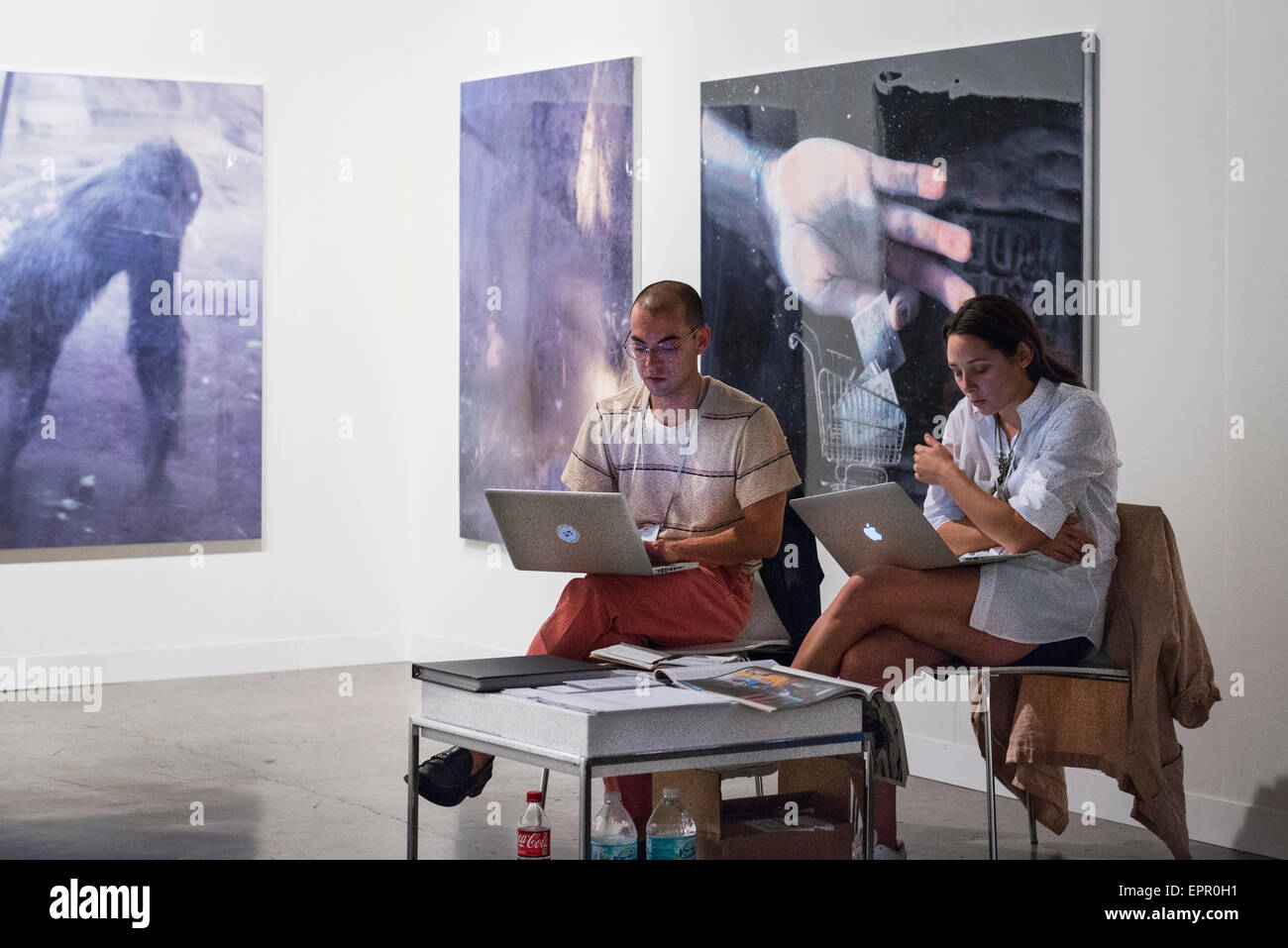 Florida Miami Art Basel international fair exhibition modern contemporary paintings pictures sculptures man girl Stock Photo
