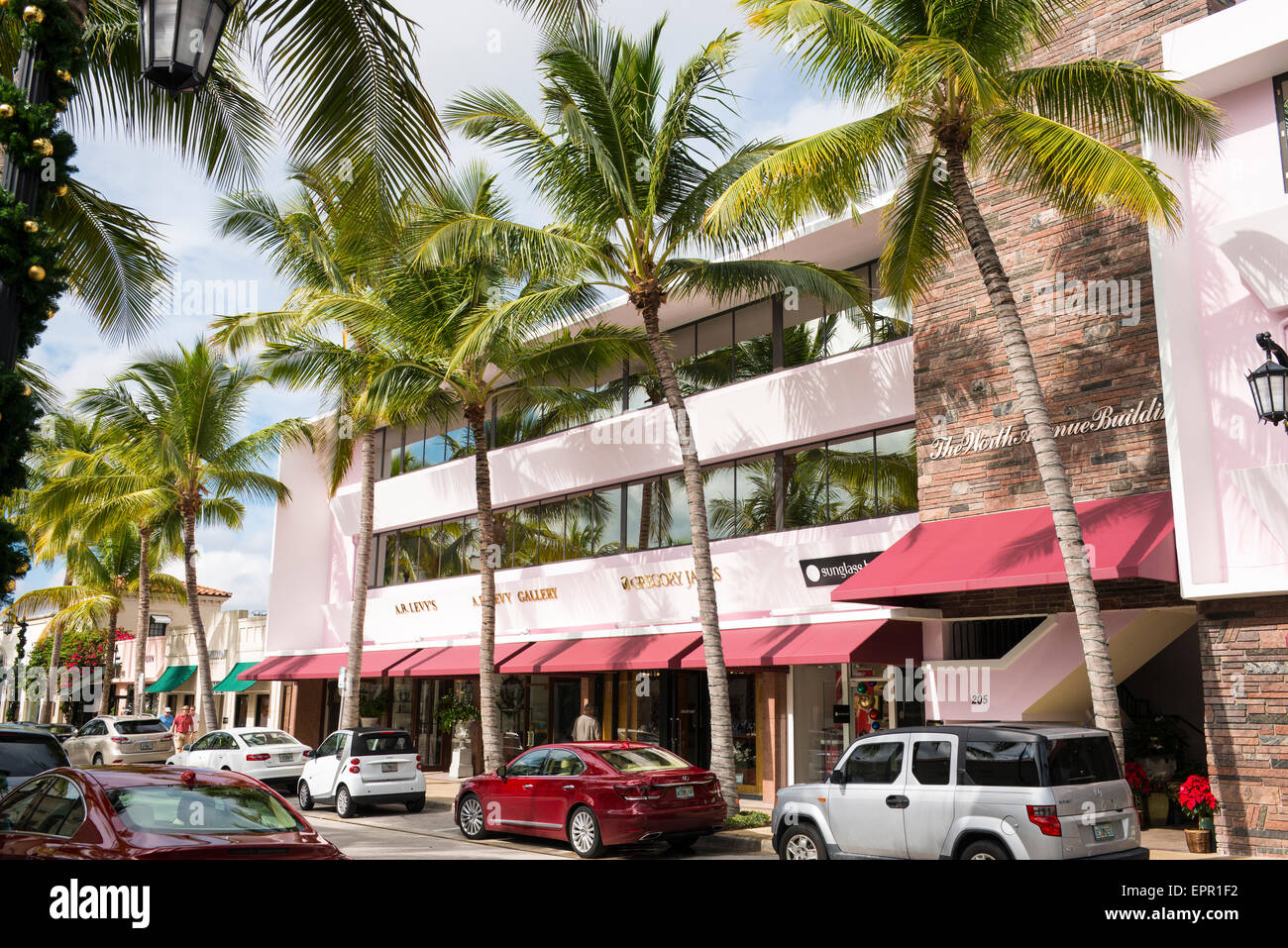 Florida Palm Beach Worth Avenue luxury shopping street road palm trees A B Levy auctioneers Stock Photo