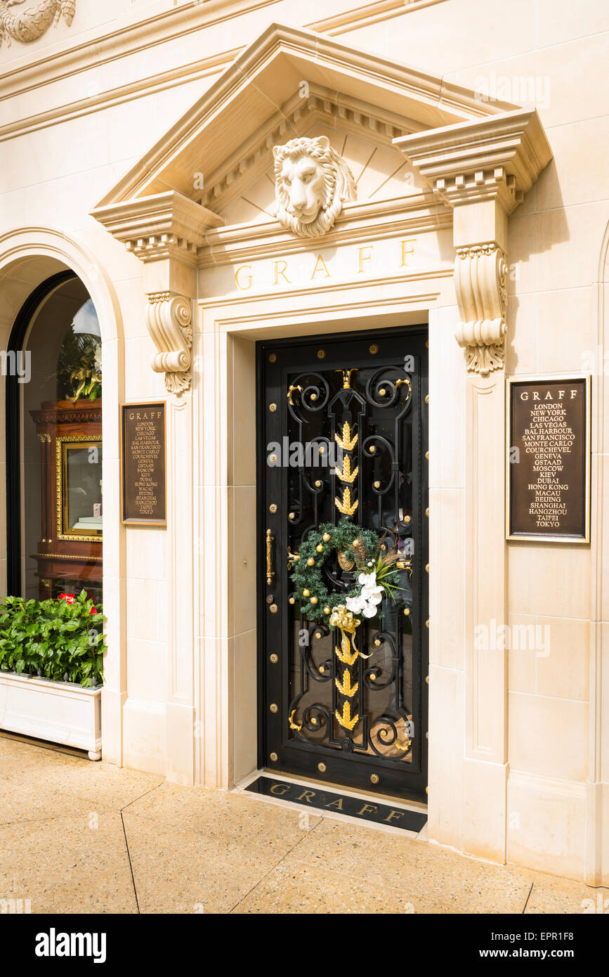 Florida Palm Beach Worth Avenue luxury shopping street road Graff jewelry shop store with Christmas Xmas wreath - Stock Image