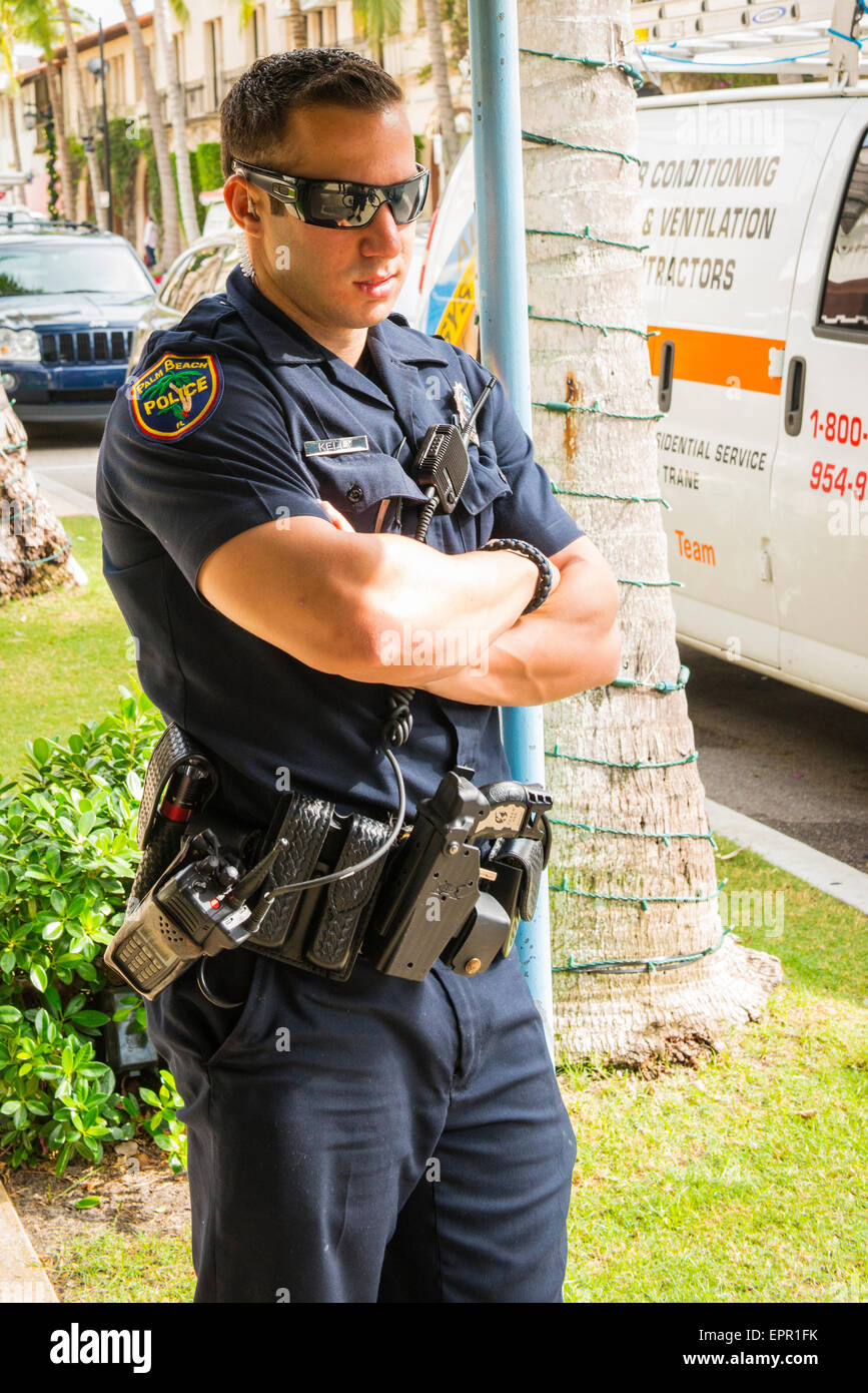 Florida Palm Beach Worth Avenue luxury shopping street road police Officer Kelly copon duty in uniform armed & - Stock Image