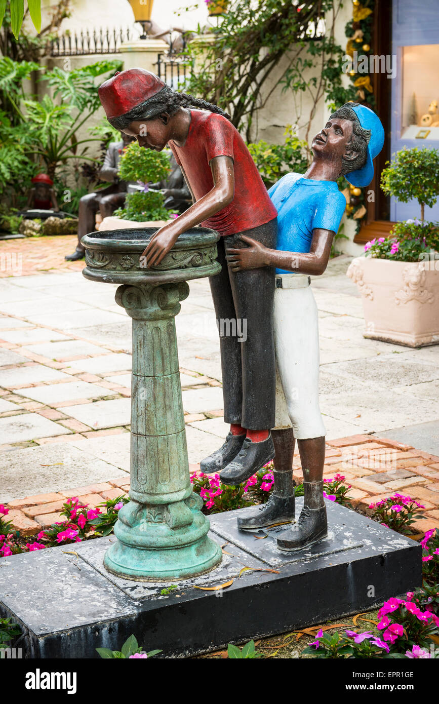 Florida Palm Beach Worth Avenue art work child children figures by artist Prince Monyo of Romania statues sculptures - Stock Image