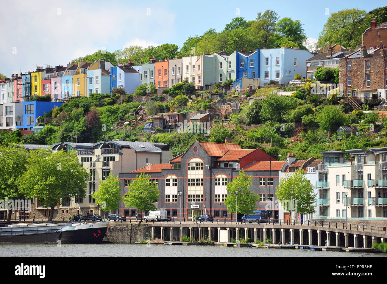 Bristol Harbour with colourful houses in the background. - Stock Image