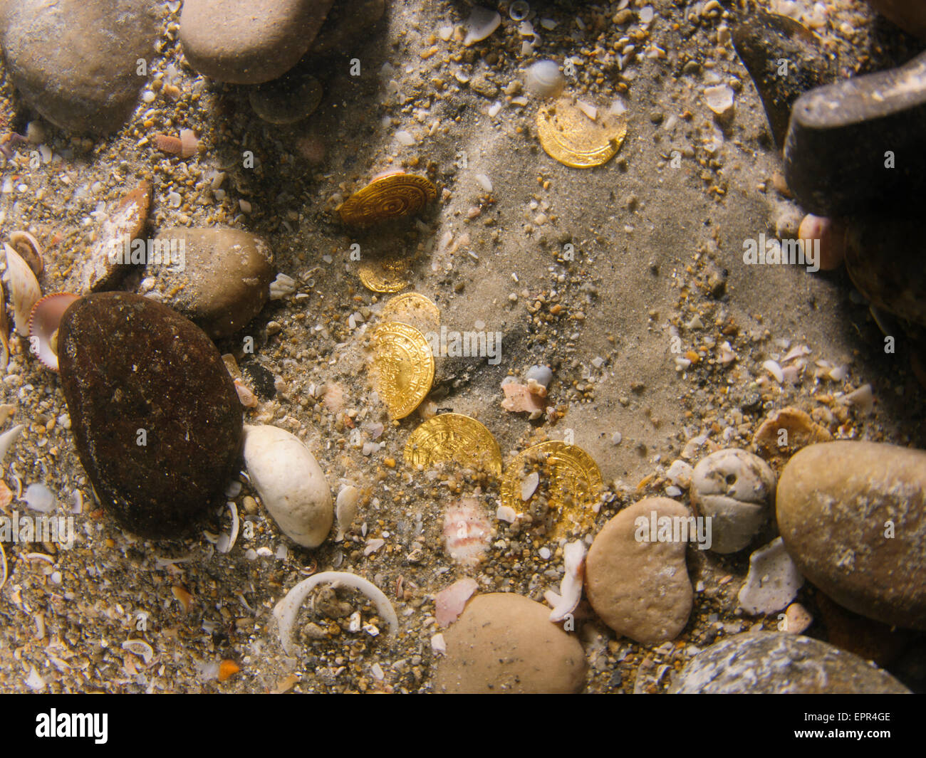 Scuba Divers uncover a hoard of 2000 gold coins from the Fatimid period (eleventh century CE) in the ancient harbour - Stock Image