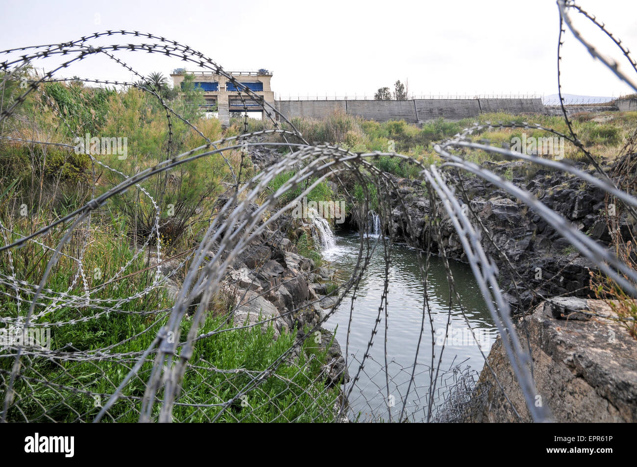 The Israeli Jordanian Border Photographed at Naharaim on the Jordan River barbed wire security fence - Stock Image