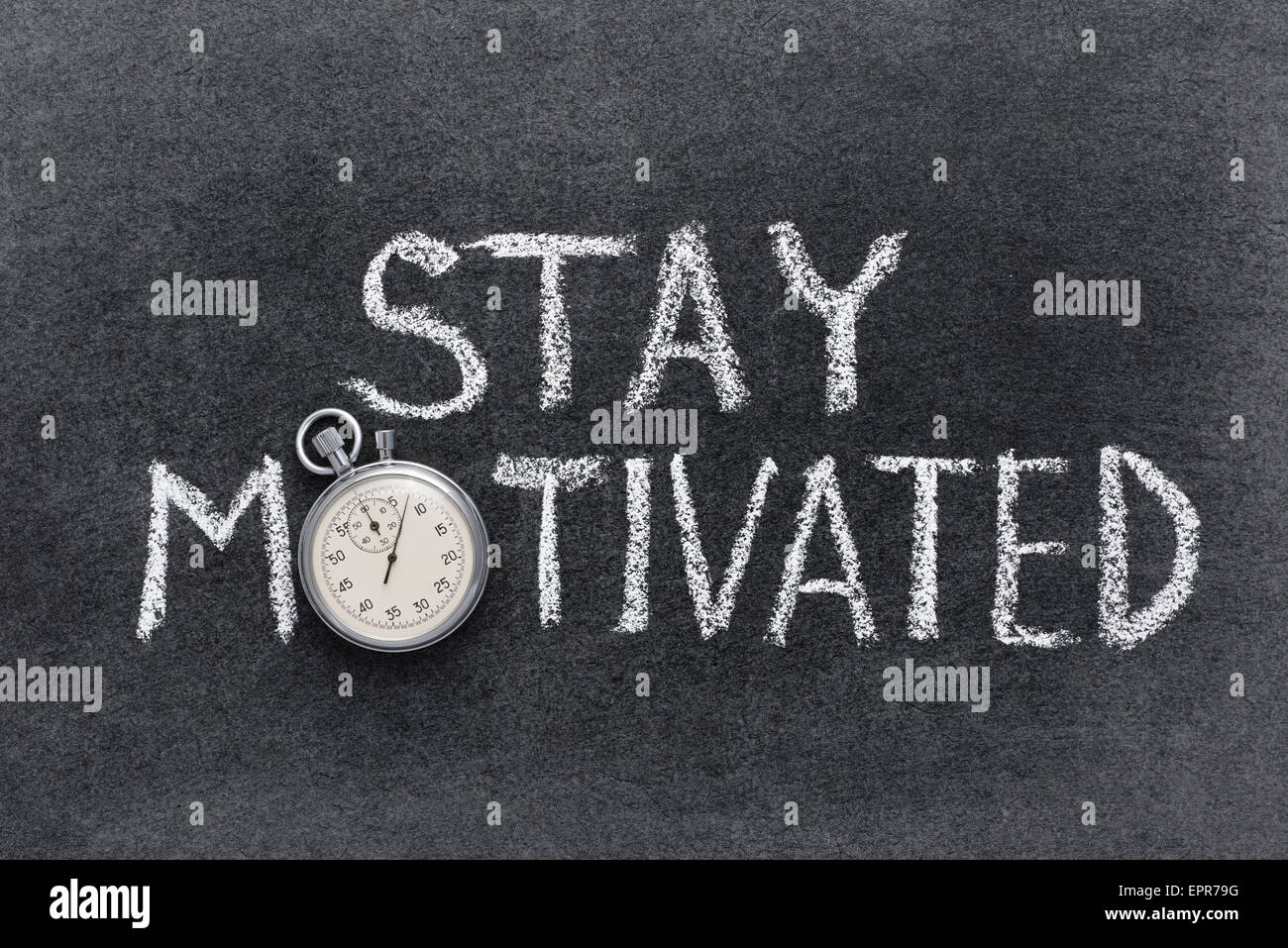 stay motivated phrase handwritten on chalkboard with vintage precise stopwatch used instead of O - Stock Image