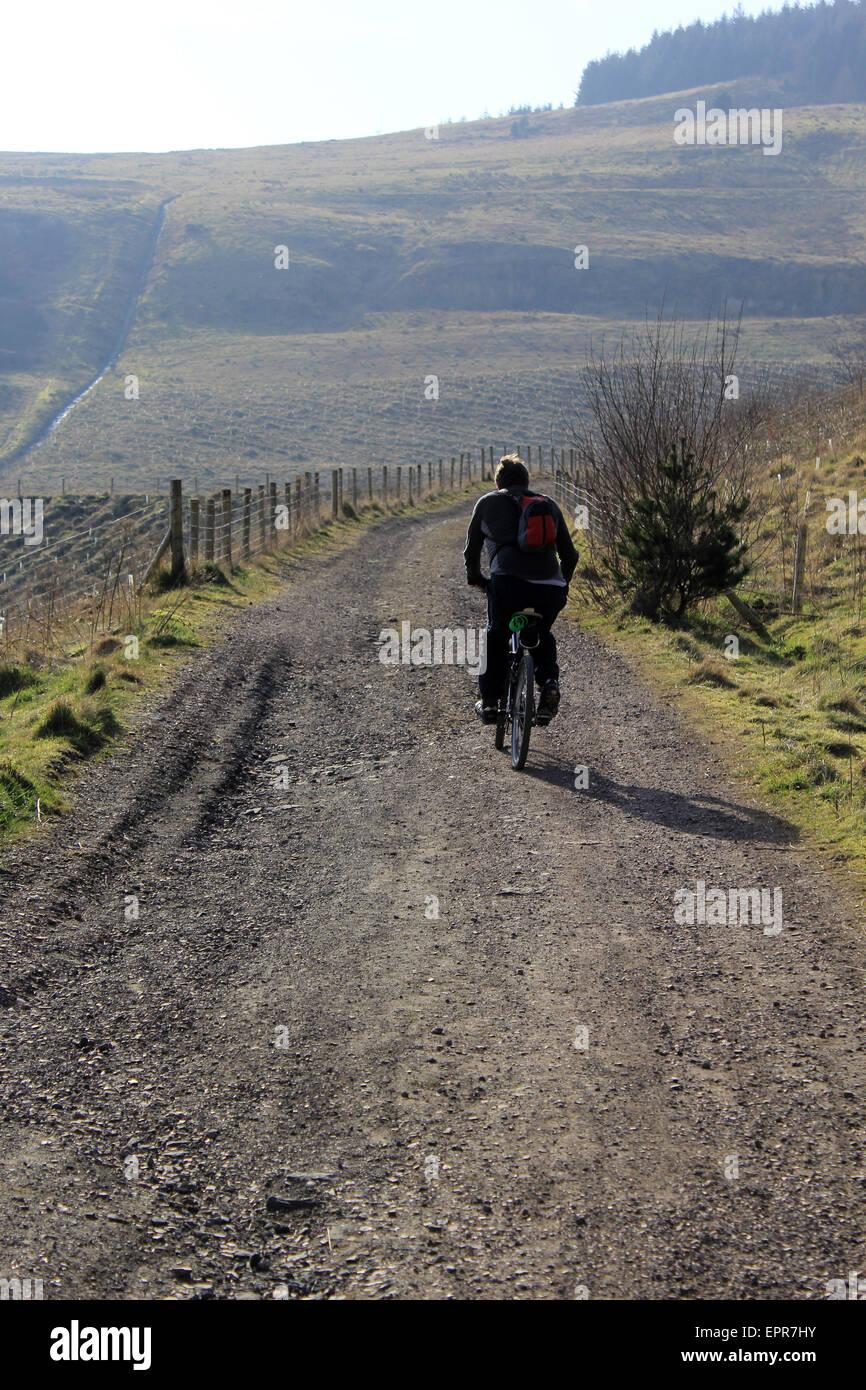 Cyclist on the  new cycle way in Blaengarw, Bridgend - Stock Image