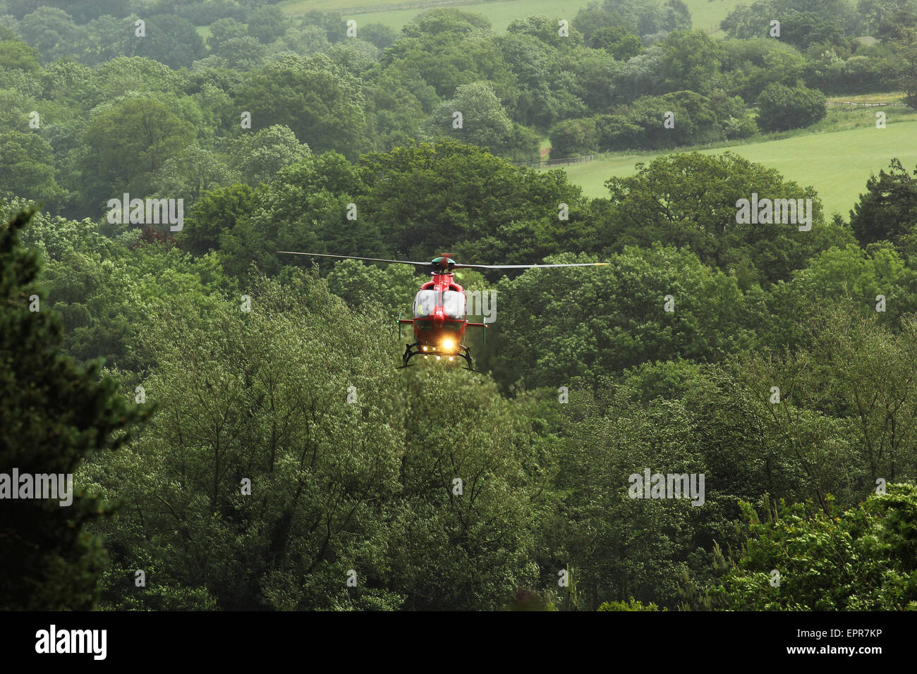 Air ambulance landing in fields near Abergavenny - Stock Image