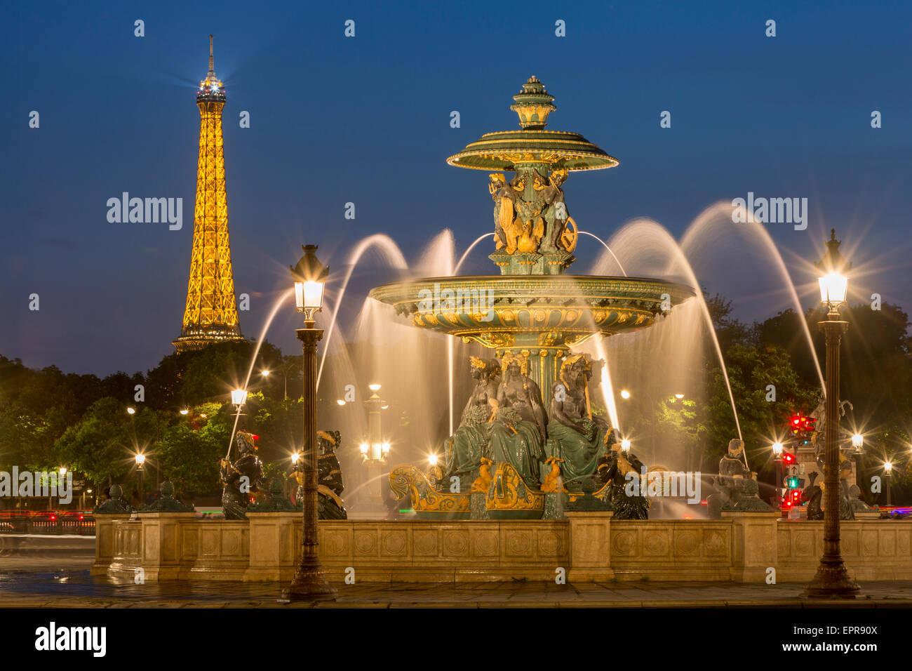Fontaine des Fleuves - Fountain of Rivers at Place de la Concorde with the Eiffel Tower beyond, Paris France - Stock Image