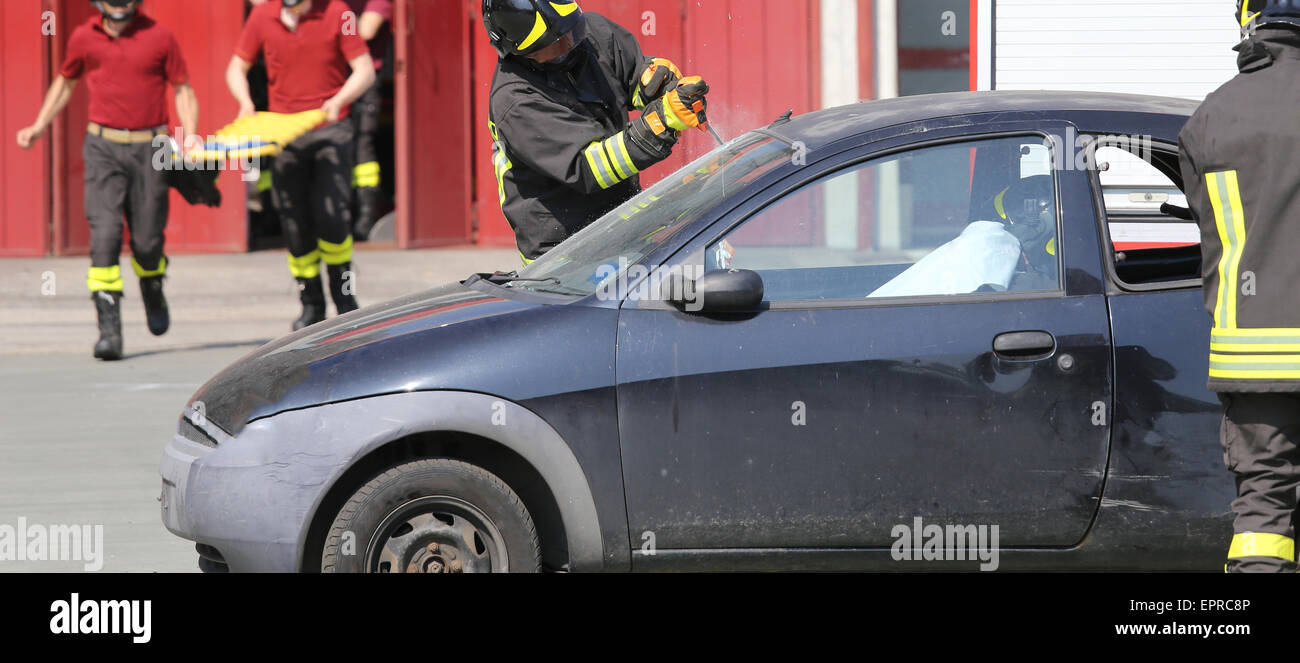 Firemen During Car Accident Simulation Stock Photos & Firemen During ...