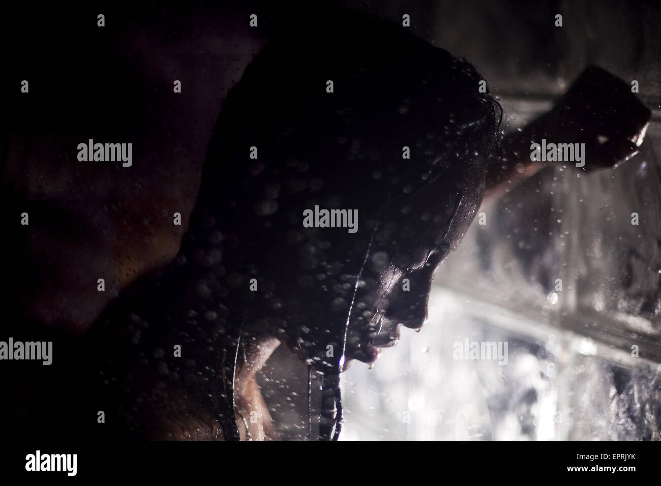 A young woman photographed in the shower in Baltimore, Maryland on December 1. - Stock Image