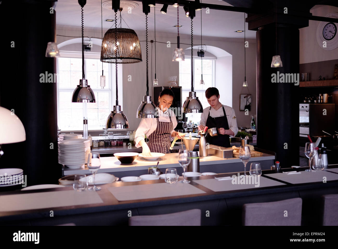 Young waiters at the 3 chef restaurant 'Tam labam bus augt' ( Translation - What's Good Will Grow) in - Stock Image