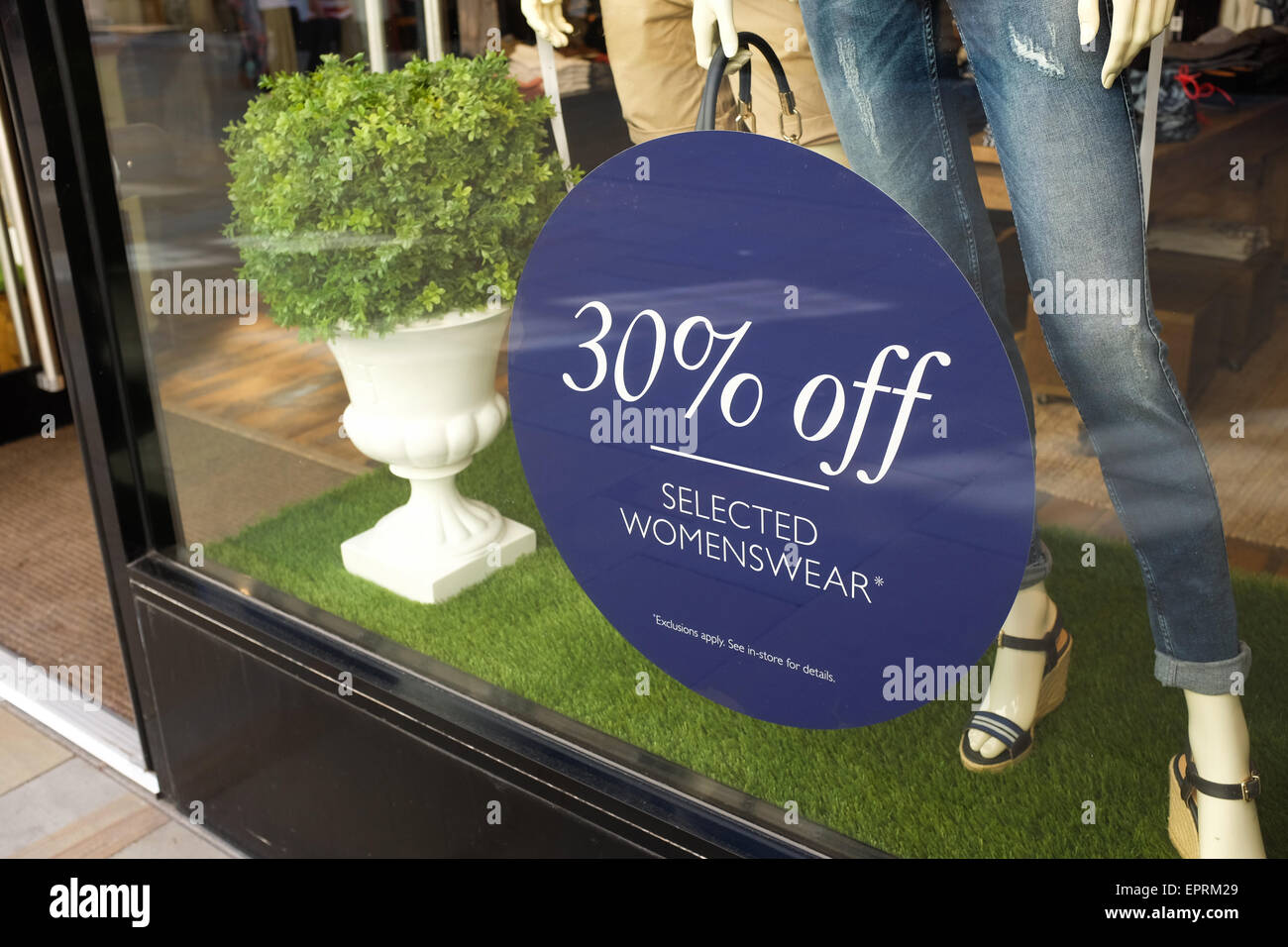A shop with a 'sale' sign. - Stock Image