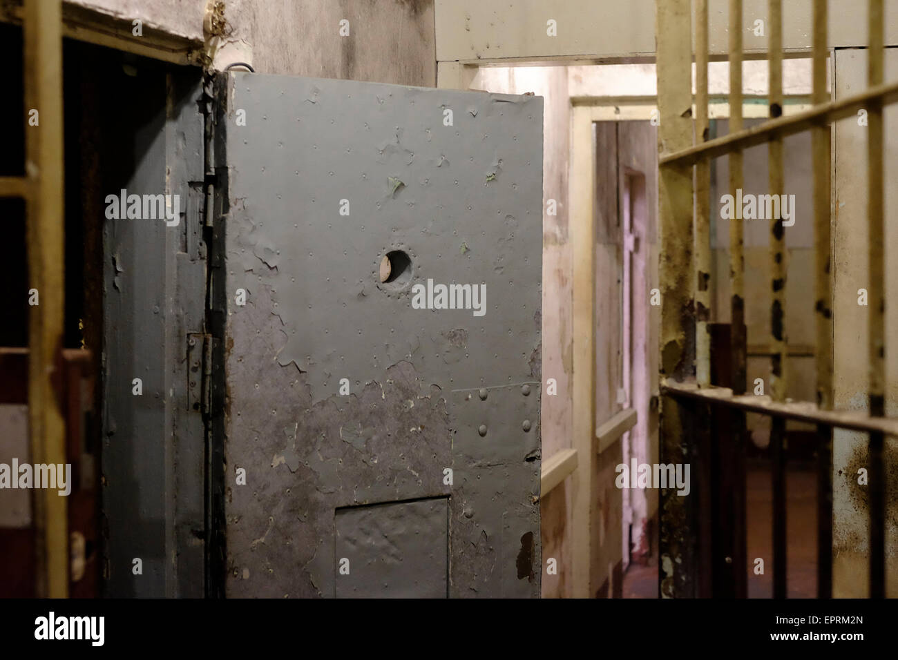 Basement prison cells at the former KGB, or 'Cheka' headquarters known by locals as the Corner House in Riga capital - Stock Image
