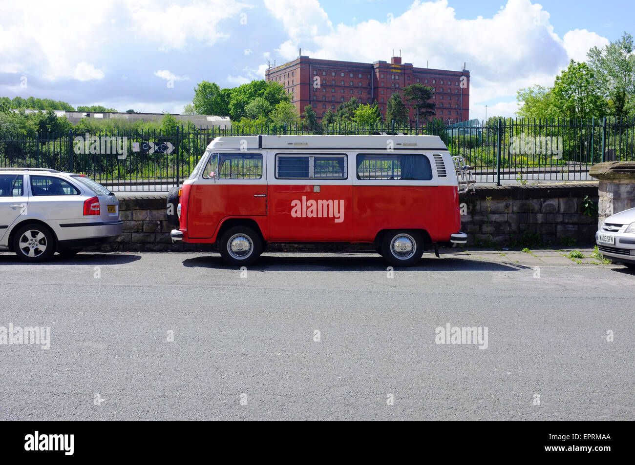 A vintage red and white VW campervan parked on the side of the road in Bristol, UK. - Stock Image