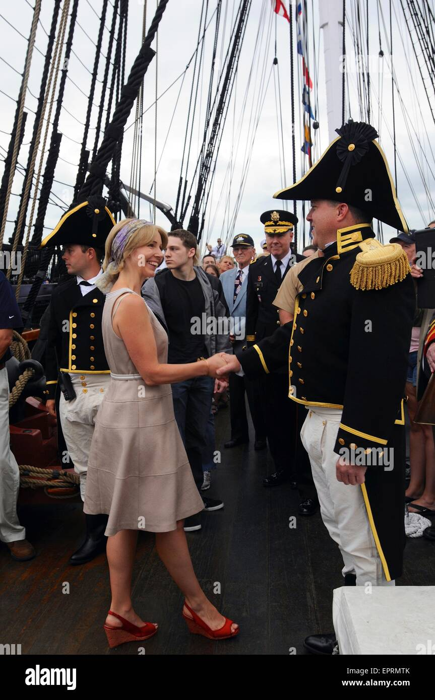 U.S. Navy Cmdr. Sean Kearns, 73rd commanding officer of USS Constitution, greets guests prior to getting underway - Stock Image