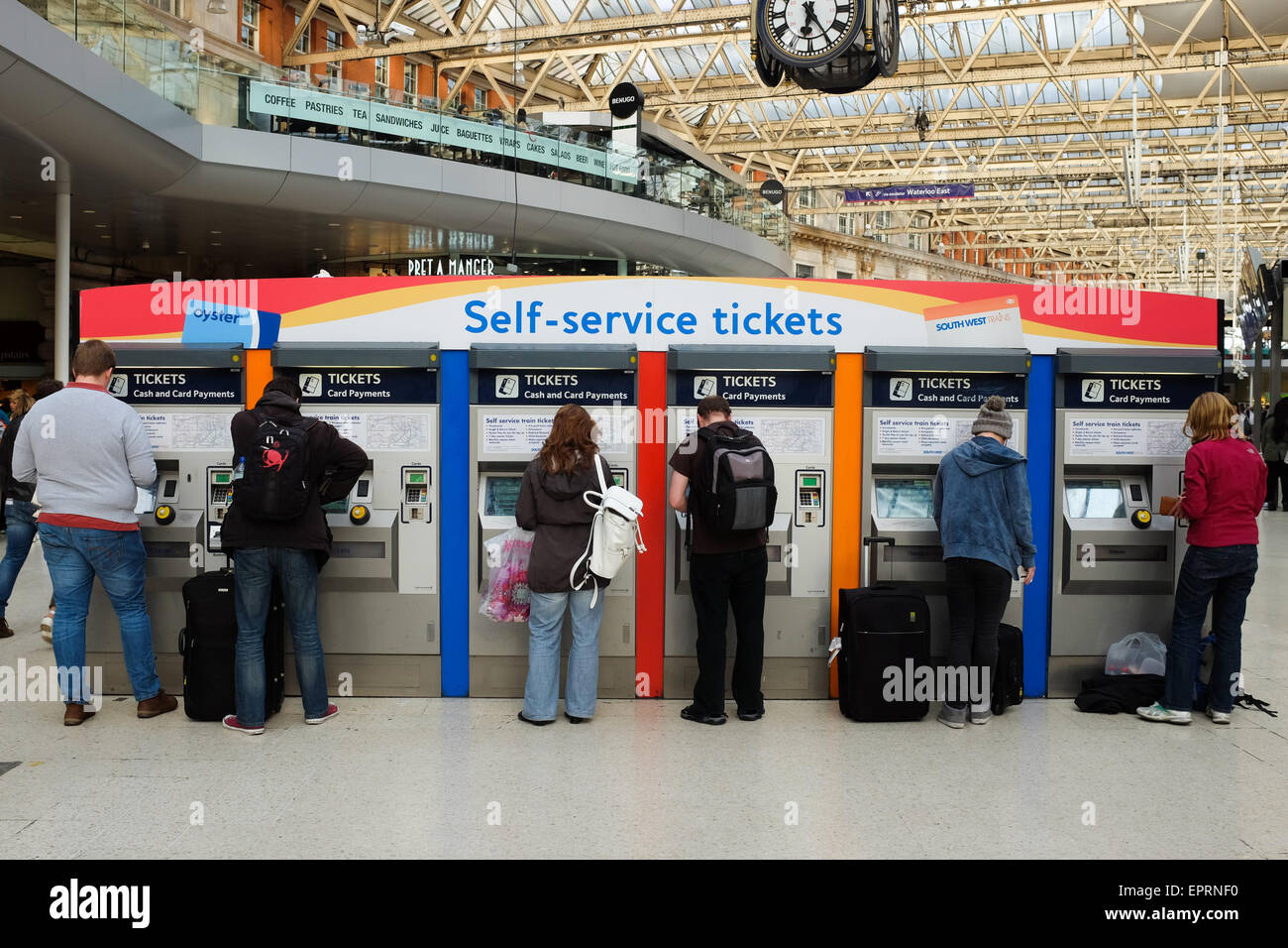 Machines selling train tickets at Waterloo station in London, England. - Stock Image