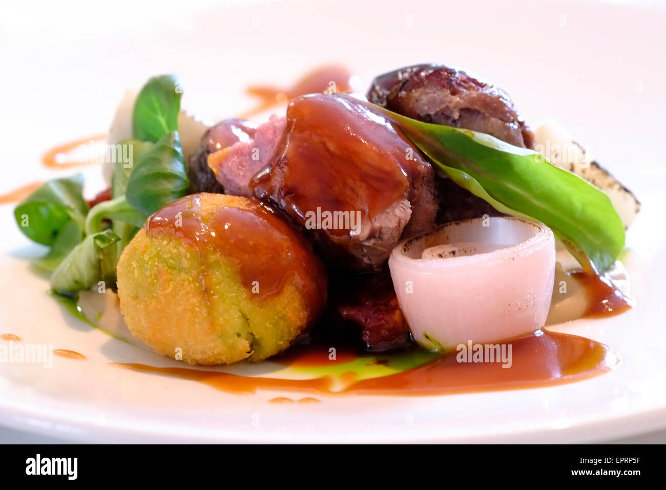 Gourmet dish served  at the 3 chef restaurant 'Tam labam bus augt' ( Translation - What's Good Will - Stock Image