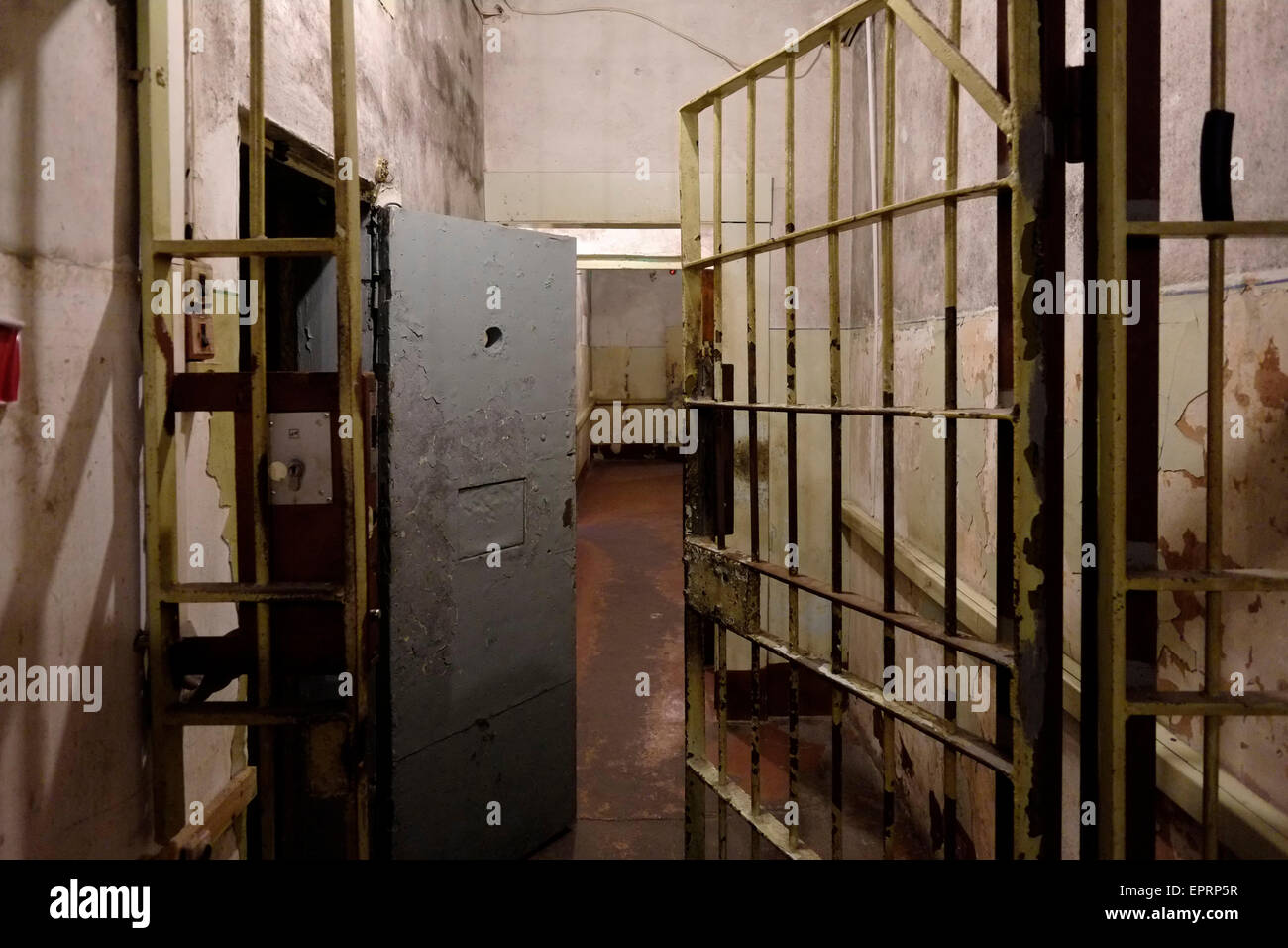 View of the basement prison cells at the former KGB, or 'Cheka' headquarters known by locals as the Corner House - Stock Image