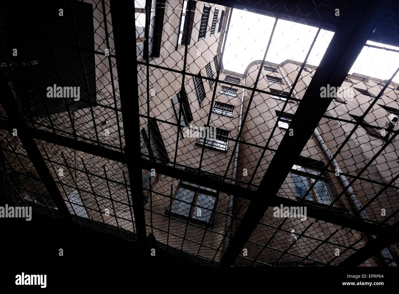 Ceiling fence covering the basement prison courtyard at the former KGB, or 'Cheka' headquarters known by locals - Stock Image