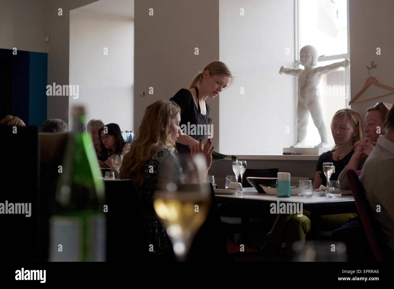 People dining at the 3 chef restaurant 'Tam labam bus augt' ( Translation - What's Good Will Grow) in - Stock Image