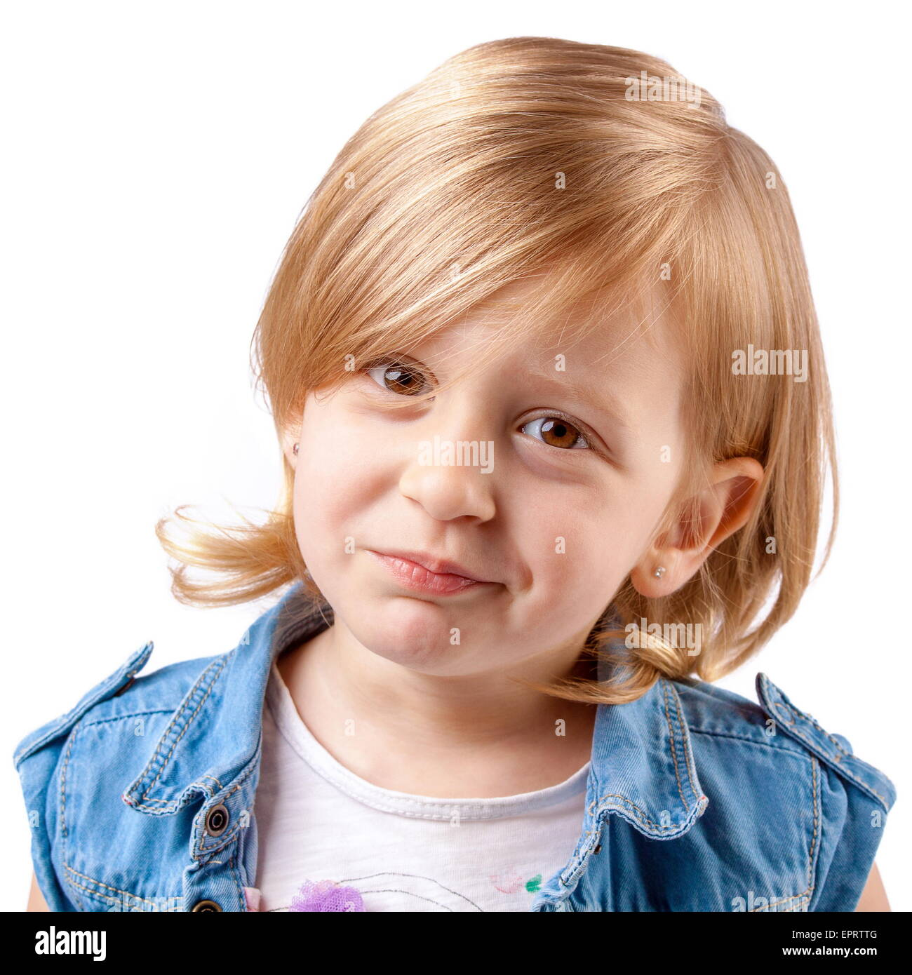 Little cute girl smiling and having fun - Stock Image
