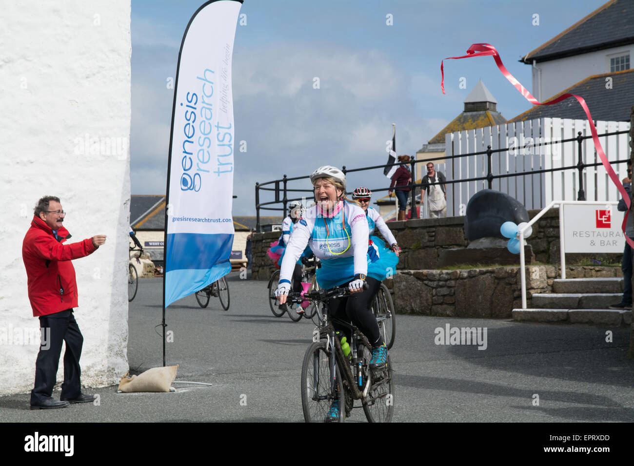 Lands end, Cornwall, UK. 21st May 2015. TV celebrity Fern Britton completing her John O Groats to Lands End cycle Stock Photo
